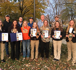 Photo of Michelle Johnson, Madison Folk, Shelby Judd, Kaiti Collins, Shelby Fryar, Kristy Kruger, Katie Hoffman, Matt Holste, Aaron Ackerman, Justin Kalina, Leland Houzenga, Andrew Gustafson